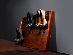 """""""Looking for a simple rack for your wife's shoes? You won't find a more practical one,"""" we said in January 1961. Drill holes to fit the heels, and mount the panel so it stands proud of the closet wall.   - PopularMechanics.com"""