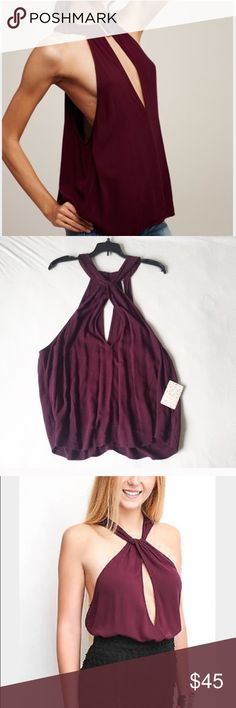 NWT Free People Twist & Shout Wine Color Tank NWT Free People reversible Tank in color Wine... super adorable and gorgeous color!! Size large. Bought from Nordstroms. Can be worn both ways. With either buckle in front of back. Free People Tops Tank Tops