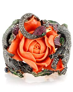 Wendy Yue Carved Coral Rose Cuff.     Original and unusual cuff with red rose and jewelled snake. SSSSuper!    If you like it please repin, like or leave a comment, thanks.    Source: stanleykorshak.com    20130117 14:08