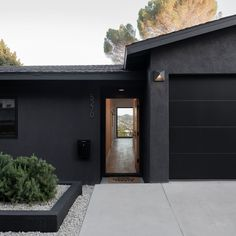 Clean lines and a sleek black exterior welcome you to this North Highland Park hilltop home. Tagged: Exterior, House Building Type, Stucco Siding Material, Mid-Century Building Type, and Shingles Roof Material. Raber By VEIN. Black Windows Exterior, Black House Exterior, Black Shutters, Stucco Homes, Stucco Exterior, Exterior Design, Stucco Colors, Exterior Paint Colors, Siding Options