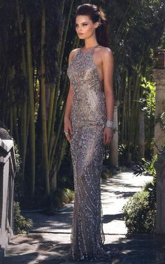 Prom Dresses Evening Dresses by SCALA<BR>asc48585<BR>Halter neckline long gown, open back and sheer overlay with swirling bead work pattern.