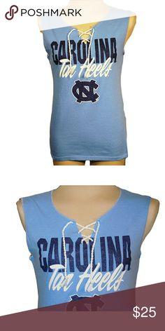 "North Carolina Tarheels Blue split front tank North Carolina Tarheels Blue split  from an upcycled cotton/poly t shirt.  Shirts may have side or back panels of cordinating colors   SIZE CHART Small fits 32""-34"" Medium fits 34""-36"" Large fits 36""-38"" XL fits 38""-40"" XXL fits 40""- 42 Tops Tank Tops"