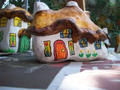 55...a finished fairy house with an orange front door and plants in the windows By @gennepher