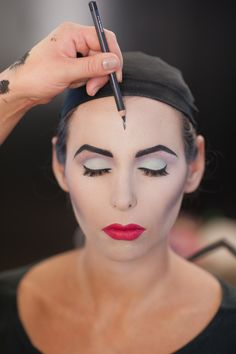 Step 11: Create a deep widow's peak by marking a spot in the center of your forehead with a black liner. Then trace out the shape to ensure symmetry.  #refinery29 http://www.refinery29.com/diy-halloween-makeup-looks#slide-11