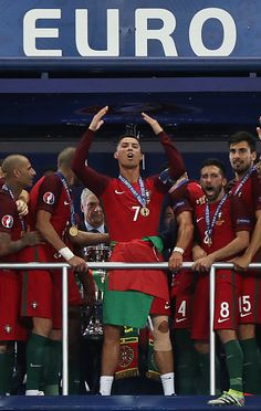 #EURO2016 Portugal's midfielder Andre Gomes Portugal's midfielder Joao Moutinho and Portugal's forward Cristiano Ronaldo celebrate after they beat France...