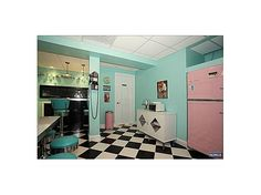 I would just die to have a retro diner style, colorful kitchen. With lots of cabinets and countertops, too.