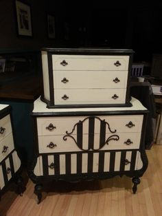 1930's highboy in black and white chalk paint. https://www.facebook.com/OlCountryChic