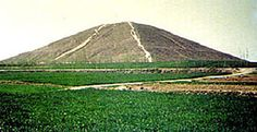 "pyramid, Qin Lin is in the ""forbidden"" zone in China, estimated at 1000 feet, made of eartha and clay, and holding vast tombs. The Chinese Government denied the existance of 100 or so pyramids. The Government even planted trees on them to disguise them"