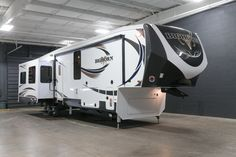 """PREMIUM AND ELEGANT FULL TIME RV!  2017 Heartland Bighorn 3875FB Full-time living has never been better! You'll appreciate over 140 cubic feet of storage, the largest exterior storage in its class! You'll stay toasty during the colder months with the powerful 42,000 BTU furnace! This 41'9"""" and 13,355 pound rig has an impressive 135 gallon waste water capacity! Give our Bighorn expert Tim Knauss a call 616-710-4579 for pricing and more information!"""