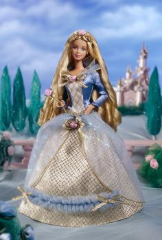 Inspired by the magical story of Princess Aurora and her dashing suitor, Barbie® as Sleeping Beauty makes a fine addition to the Children's Collector Series. She's dressed in a delicate blue and golden gown fit for a princess. Her satin bodice is accented with golden ribbons and has a sparkling collar that frames her face. To complete the fairy tale look, she has a bejeweled golden crown
