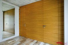 Skryté dvere v drevenom obklade / Hidden doors in a wooden wall