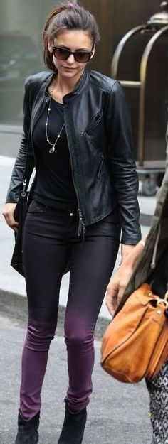 Nina Dobrev | purple skinny jeans + black t-shirt + leather jacket + booties + pony tail