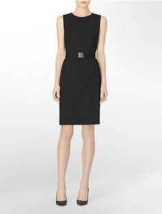 This black sleeveless dress features a detachable belt and slight scoopneck.