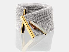 Cuff | Adami & Martucci. Renown for their innovation in silver mesh jewellery