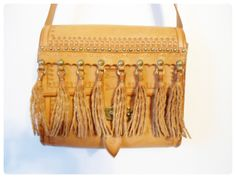 Vtg Tooled Leather Purse with Fringe - Boho, Hippie, Western Shoulder Bag Cross Body Satchel. $69.95, via Etsy.