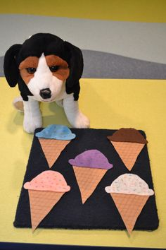 "September 2014.  THEME:  Sweet Treats.  This fun rhyme complete with a snarfing and chomping dog puppet was a big hit in story time.  ""Down around the corner at the ice cream shop Were five ice cream cones with some sprinkles on top. Along came a dog with a dollar to pay. He bought one and took it away."