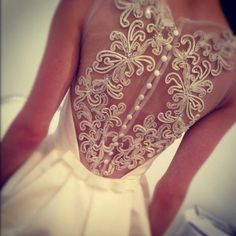 This white dress with a beautiful back