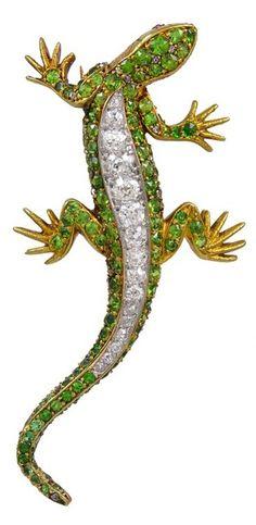 Demantoid Garnet Diamond Gold Lizard Brooch, circa late 1880's. A stunning demantoid garnet and diamond 18k yellow gold lizard brooch. There is approximately .63cts total in diamonds. Via 1stdibs.