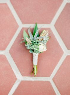 air plant boutonniere - photo by Elyse Hall Photography http://ruffledblog.com/tucson-hacienda-wedding-inspiration