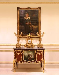 Oil painting by Léon Moricourt Douai 1830 – Paris 1908 A young girl and two boys at a fireplace Signed, inscribed and dated: Pont Aven 94; Gilt bronze clock garniture by Raingo Frères 1813, Paris; A French ormolu-mounted kingwood, bois satine and Vernis-Martin Commode by A. Chevrié, last quarter 19th century