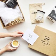 """""""Wait. C O F F E E mail? This has to be the best thing ever. Coffee beans, coffee candle, coffee scrub, ceramic coffee cup AND packaging after my heart. Thank you so much @theparcelproject // and beautiful @thatreyes ☕️❤️"""" Photo taken by @emmakateco on Instagram"""