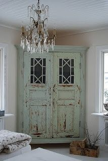 re-purposed doors and molding.....perfect corner cabinet/storage