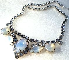 "vintage necklace""JULIANA"" stylesilver tone festoon style with blue rhinestones& round, navette & a tear-drop shaped moonstone/opal-esq caboch...  #blue #cabochon #moonstone #silver #vintage #jewelry"