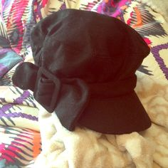 Black Cabbie Hat This super cute black cabbie hat features a cute bow and brim.  New with tags! August Accessories Hats