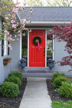 Exterior house colors - gray & black with red door.      From:  http://www.houzz.com/gray-house/p/16#