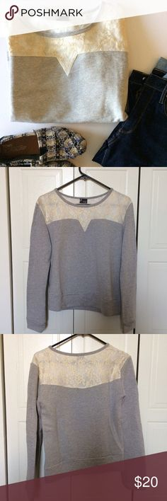 Pullover sweatshirt from Urban Outfitters. EUC. Very pretty, lighter pullover sweatshirt from Urban outfitters. It's by the brand Sparkle & Fade. Size small. Only worn and washed once. The lace detailing at the top is Gold and white. Urban Outfitters Tops Sweatshirts & Hoodies