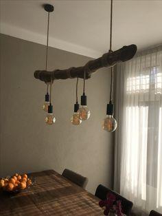 Maak zelf eenvoudig van een mooie tak/boomstam een sfeervolle hanglamp.