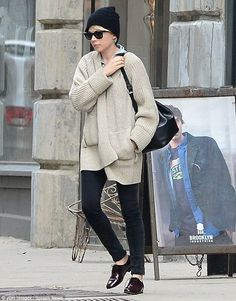 Michelle Williams goes for androgynous look in oversized cardigan