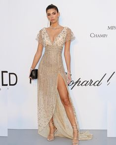 A glowing Cindy Mello at the amfAR gala during the Cannes film Festival in a nude, silk tulle gown with a deep-V bust and empire waist embroidered with bronze beads from GEORGES HOBEIKA's Haute couture spring summer Dressy Dresses, Cute Dresses, Cindy Mello, Tulle Gown, Gowns Of Elegance, Haute Couture Fashion, Beautiful Gowns, Special Occasion Dresses, Chic Outfits