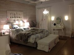 Ikea Bedroom - like the foot benches.. i want to become this bed it looks so comfortable