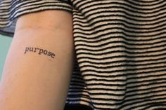 """""""Purpose"""" on the forearm."""