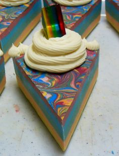 Cold process mango soap cake slices - I'm not sure how they made that rainbow embed slice, but the rest of the cake looks pretty easy to make: layered solid colors with a swirled rainbow layer and whipped soap frosting on top Soap Cake, Cupcake Soap, Cupcake Cakes, Cupcakes, Diy Soaps, Homemade Soaps, Cake Slices, Therapeutic Essential Oils, Bath Tea