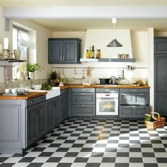 Country chic kitchen- absolutely in love with those floors and cabinets!