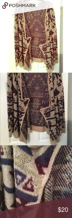 Daytrip Cardigan Great Daytrip Cardigan with Aztec print. Adorable glitter thread detail. Some small pulls in the material. Great condition other than the pulls. From a smoke and pet free home. Daytrip Sweaters Cardigans