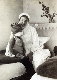 +~+~ Vintage Photograph ~+~+ Nurse lovingly cares for wounded child.