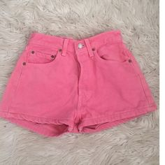 Levi Pink High-Waisted Shorts Obsessed with these shorts but unfortunately are to small for me now. I would love for someone else to enjoy them! Vintage and to die for! Only some minimal wear that actually add to the shorts! Noticeable where is pictured and is by the button. I bundle, just ask or use the bundle feature!  Levi's Shorts