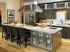 Gripping Kitchen Island with Stove Top and Seating also Granite Cutting Board and Frosted Glass Panels for Cabinets with Stainless Steel Frame and Square Cabinet Knobs from Kitchen Island Plans