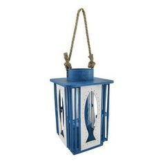 Cutout Blue and White Fish Candle Lantern - Ahoy! Reel in this nautical themed lantern! From its blue and white distressed painted wood, to ...