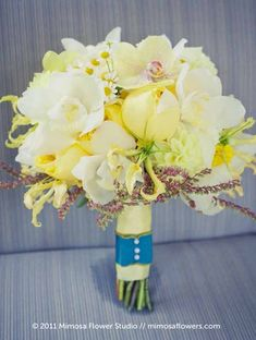 Mimosa Flower Studio - hand-tied bridal bouquet of yellow orchids, yellow garden roses, chamomile, white cymbidium orchids and yellow dahlia...
