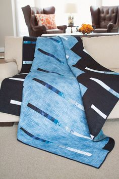 This quilt has a modern slant to the bargello technique. The thin strips in the quilt have gradated blue to black fabrics.