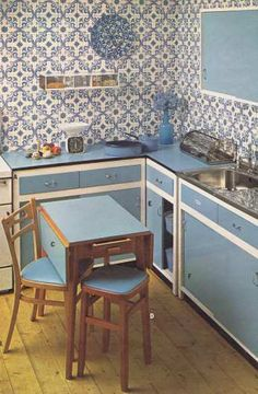 70s Kitchen circa 1970 from Burtons    I think the big design difference to modern kitchen are that the doors weren't hinged but simply slid from left to right. 70sstyle