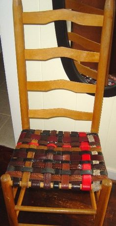 Weaving a chair bottom from old leather belts.