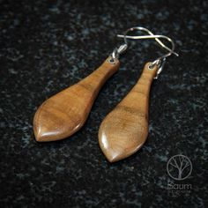 Lightweight and comfortable, these wooden earrings are made from Poplar, carved and finished in a way that makes them somewhat resemble stone. Sealed with an oil finish to enhance and protect. This pair has stainless steel hooks. 1.8L x .7W (45mm x 16mm)  Wooden earrings are durable enough for normal daily wear. We do advise you remove them however, when swimming or bathing. And take a little extra care when handling and storing.