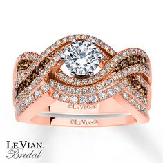 Round Chocolate Diamonds® and Vanilla Diamonds® swirl around the Vanilla Diamond center of her luscious engagement ring in this set from the Chocolate Wedding® Collection by Le Vian Bridal®. The wedding band, featuring more round Vanilla Diamonds®, is contoured to fit around the engagement ring. The bridal set, fashioned in 14K Strawberry Gold®, has a total diamond weight of 1 1/3 carats. Le Vian®. Discover the Legend. Diamond Total Carat Weight may range from 1.29 - 1.36 carats.