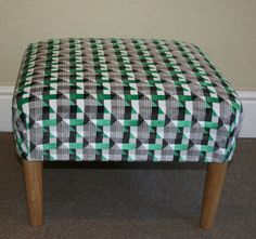 This footstool has been upholstered in fabric from the Underground collection from Kirkby Design. This is from the Piccadilly line and is available in seven different colours.