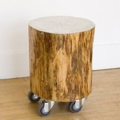 TAMARA CODOR Silver Leaf Stump Roller >> SEATTLE, WA >> Finding a new life on wheels, the playful salvaged wood Stump Roller works around the home or studio as a spare seat, a bedside table, or clustered with friends as a modular coffee table. We love the high gloss silver leaf top. Contact us for custom stains and finishes and for seating sets. $500 at NuBe Green